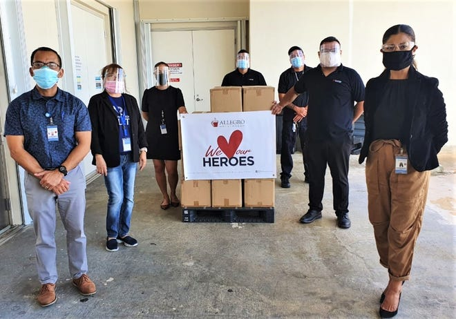 Allegro Beverage Corporation made a donation of fruit purees and beverages to the Guam Regional Medical City. Pictured from left are: Bernie Lobaton, GRMC; Litz McKinnon, GRMC; Nina Duenas, GRMC; Ishidoro Borja, ABC; Anthony Seman, ABC; Dwight Buena, ABC; and Charlotte Huntsman, GRMC.