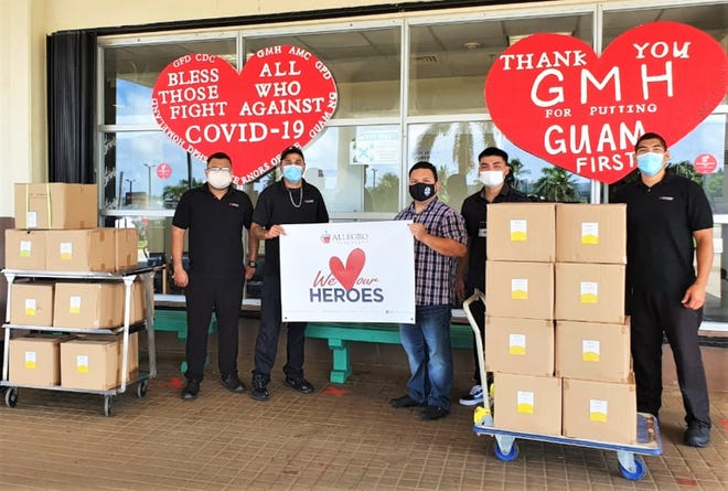Allegro Beverage Corporation made a donation of fruit purees and beverages to the Guam Memorial Hospital. From left: Dwight Buena, ABC; Anthony Seman, ABC; Theo Pangelinan, GMH; and Ishidoro Borja, ABC.