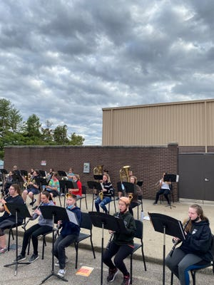 Members of the HCHS Wind Ensemble practice outside on a Fall day. The group has been chosen to perform at the 2021 Kentucky Music Educators Association Annual Conference.