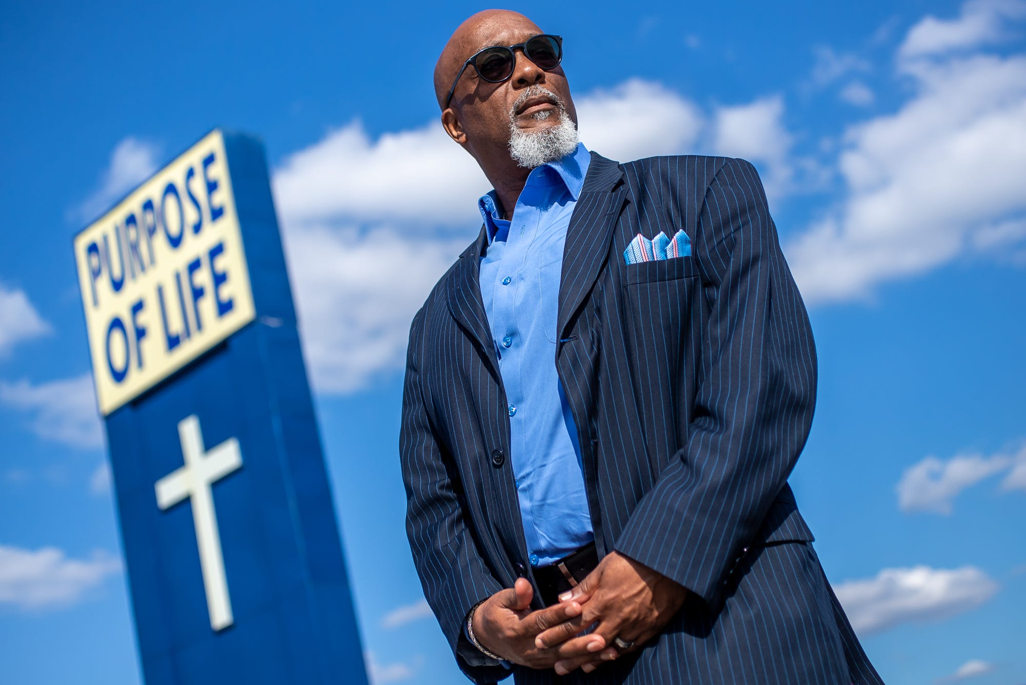 """Rev. David Greene Sr., senior pastor at Purpose of Life Ministries and president of Concerned Clergy of Indianapolis, poses for a portrait outside of his church in Indianapolis on Friday, Sept. 25, 2020. Concerned Clergy of Indianapolis is an advocacy organization that began in the 1960s as part of the civil rights movement, focusing on economics, education, health and public safety. """"Many times, the police department sees it as us versus them, and them is everybody else,"""" Greene said. """"And so if you don't agree with all their policies and practices that you're against them when in reality you're not against them. I want to see every police officer go home. We don't want to see any police officer injured. We want a quality police department. We don't want to see one that takes shortcuts or exploits people, the ones whom they are duty-bound to protect and serve."""""""