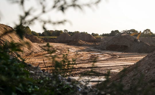 A path is cleared for hauling gravel at Beaver Materials gravel pit in Strawtown, Ind., Thursday, September 24, 2020.