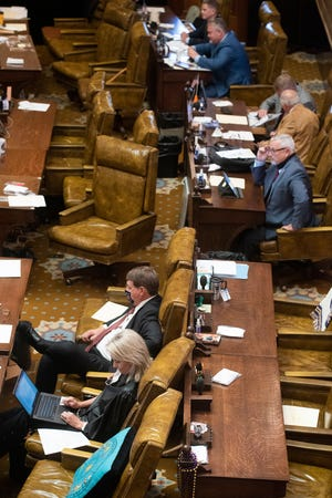 Lawmakers attend the legislative session at the Capitol in Jackson, Miss. Thursday, Oct. 1, 2020.