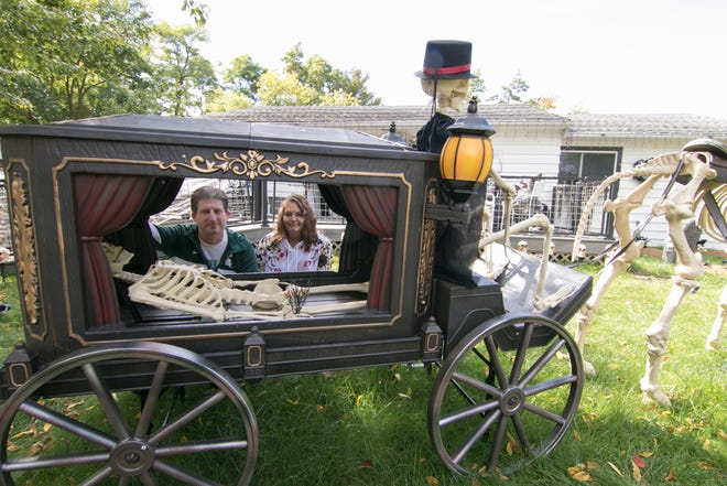 Steve and Linda Zemaitis have decorated their front yard for 15 years. They went all out with their Halloween display this year to put smiles on the faces of those who pass by. The couple poses in front of their Oceola Township home Tuesday, Sept. 29, 2020.