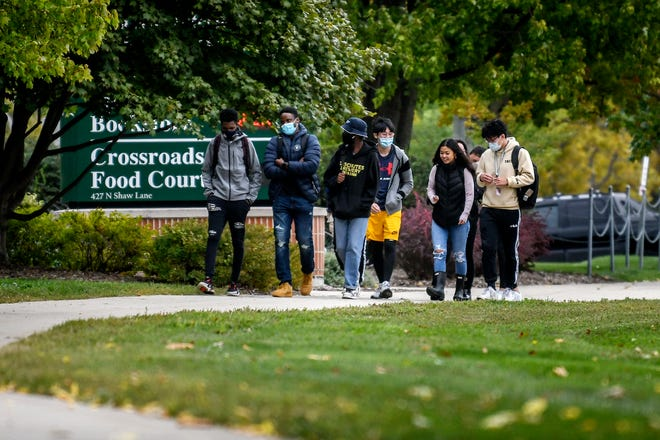 Students walk along Shaw Lane on Wednesday, Sept. 30, 2020, on the Michigan State University campus in East Lansing.