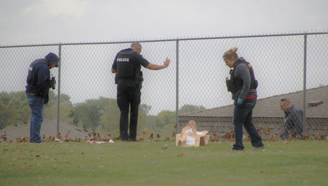Investigators from the Marion Police Department search for evidence in an area along Crescent Heights Road where a man shot himself on Wednesday, Sept. 30, 2020. The man later died from his wounds.