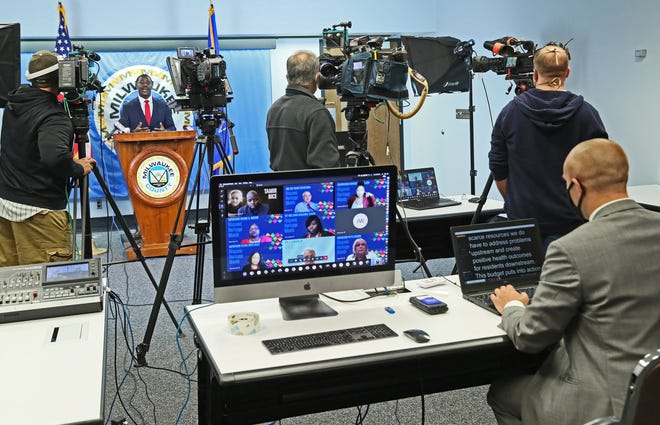 Milwaukee County Executive David Crowley gives his budget address virtually from his office at the Milwaukee County Courthouse.  This is Crowley's first budget as county executive.  Members of the County Board are shown on a computer screen at center as they participate virtually as well.