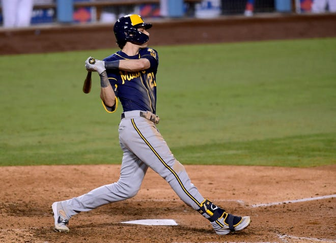 Christian Yelich strikes out to end the Brewers' 4-2 loss to the Dodgers in Game 1 of their NL wild-card series Wednesday night.