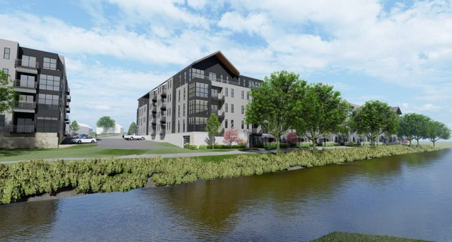 A large upscale apartment development is planned for a riverfront site in downtown West Bend.