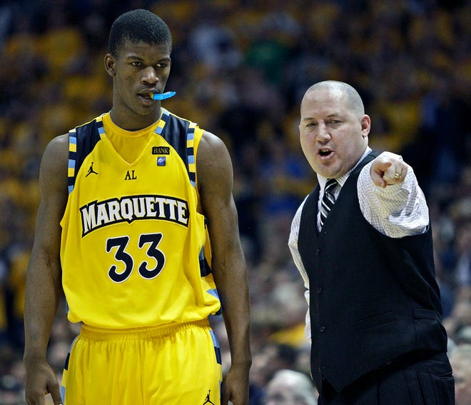 Marquette head coach Buzz Williams instructs Jimmy Butler against Notre Dame in 2011.