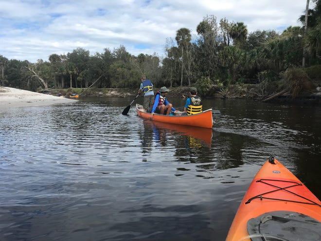 Members of Troop 2001 canoe down the peace river in December 2019.