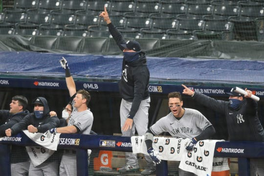 Sep 30, 2020; Cleveland, Ohio, USA; Players celebrate a grand slam by New York Yankees third baseman Gio Urshela (29) in the fourth inning against the Cleveland Indians at Progressive Field.