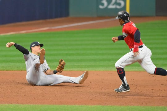 Sep 30, 2020; Cleveland, Ohio, USA; New York Yankees third baseman Gio Urshela (29) throws to second base on a double play in the eighth inning against the Cleveland Indians at Progressive Field.