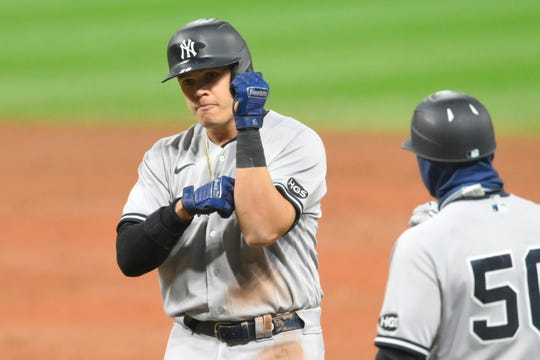 Sep 30, 2020; Cleveland, Ohio, USA; New York Yankees third baseman Gio Urshela (29) celebrates his single in the eighth inning against the Cleveland Indians at Progressive Field.