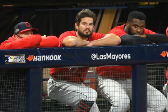 Sep 30, 2020; Cleveland, Ohio, USA; Cleveland Indians relief pitcher Brad Hand (33), center, watches from the dugout after blowing a save in the ninth inning against the New York Yankees at Progressive Field.