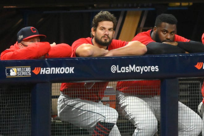 Cleveland Indians relief pitcher Brad Hand (33), center, watches from the dugout after blowing a save in the ninth inning against the New York Yankees at Progressive Field.