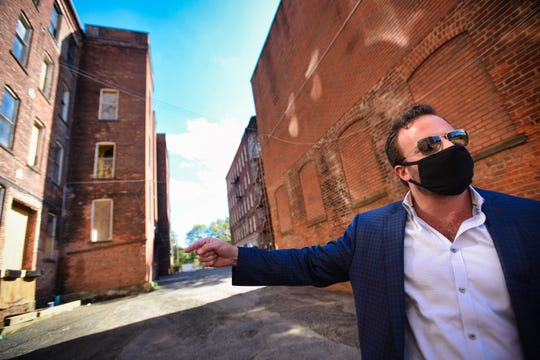 Levi Kelman, CEO of Blue Onyx Companies, who bought a complex of old mill buildings near the Passaic River for $4.2 million located in Paterson, shows around the sites, photographed on September 30,2020.