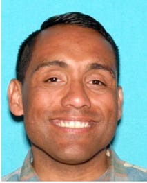 Mendivel is a 5-foot9-inch Latino man with brown hair, brown eyes. He weighs approximately 200 pounds.