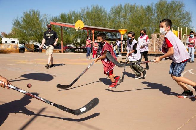 Sep 30, 2020; Phoenix, Arizona, USA; The Arizona Coyotes host a youth hockey clinic at Carl Hayden Community Center. Mandatory Credit: Rob Schumacher/The Arizona Republic via USA TODAY NETWORK