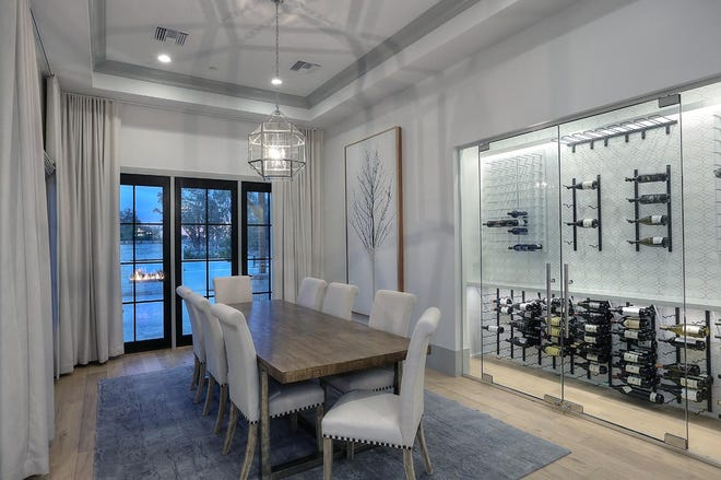 Tanveer and Sheba Shah purchased this $3.18M estate in Scottsdale. It has a glass-enclosed wine display. Robert and Linda Bradley were the sellers.