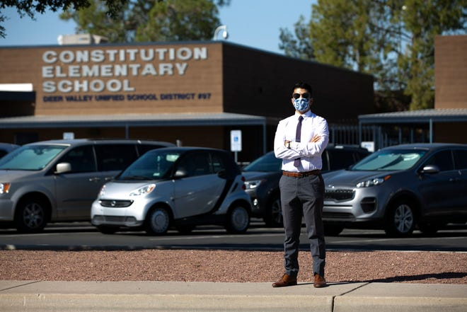 Ruben Miranda, a music and band teacher at Constitution Elementary School, part of the Deer Valley Unified School District, in Phoenix, resigned last week because of COVID-19 concerns just before students returned to the school in person. Miranda who had taught at the school for six years is seen in front of the school on October 1, 2020.