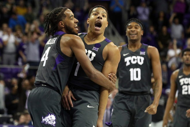 TCU guard PJ Fuller (4) hugs Desmond Bane (1) after a three-pointer against Baylor as Diante Smith (10) celebrates in the background during the second half of an NCAA college basketball game on Saturday, Feb. 29, 2020 in Fort Worth, Texas. (AP Photo/Richard W. Rodriguez).