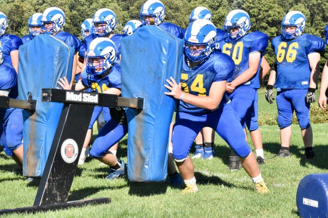 Kennard-Dale senior lineman Gabe Hulslander goes through a drill during practice. Hulslander and the Rams look to move to 2-0 against New Oxford on Friday.