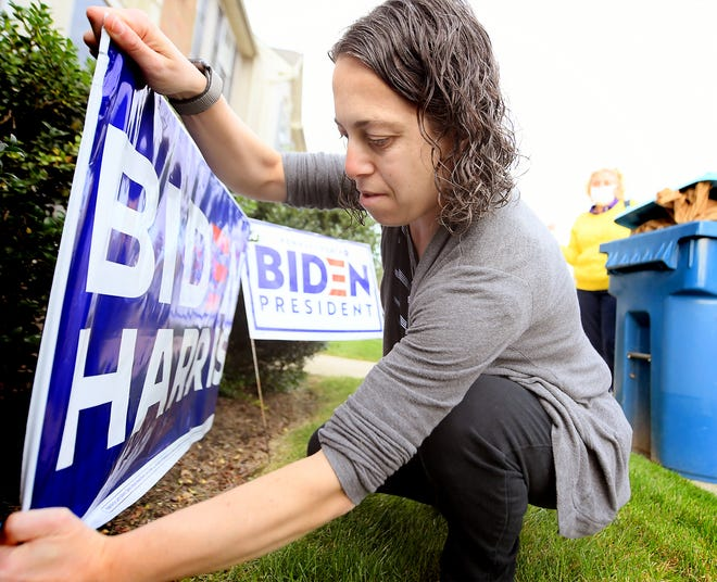 Allison Korn-Sherman of Shrewsbury Township plants a Biden/Harris sign outside her home after having it delivered by Jackie Wilson, regional director of the Democratic Party of York County, Thursday, Oct. 1, 2020. Wilson has been delivering the 110 signs she has to southern York County residents who request them. Chad Baker, chairman of the county party, said it will have distributed 5,000 Biden/Harris signs in the county. Bill Kalina photo