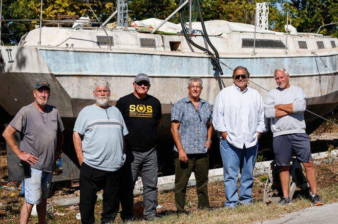 Six men Eirik Rosendahl, Kirk Murrell, Steve Eidson, Kevin Doolittle, Bill Killian and Neal Wood are planning on finishing and setting sail in the boat build by Rosendahl's dad, Robert Rosendahl, who died in Feb. of this year.