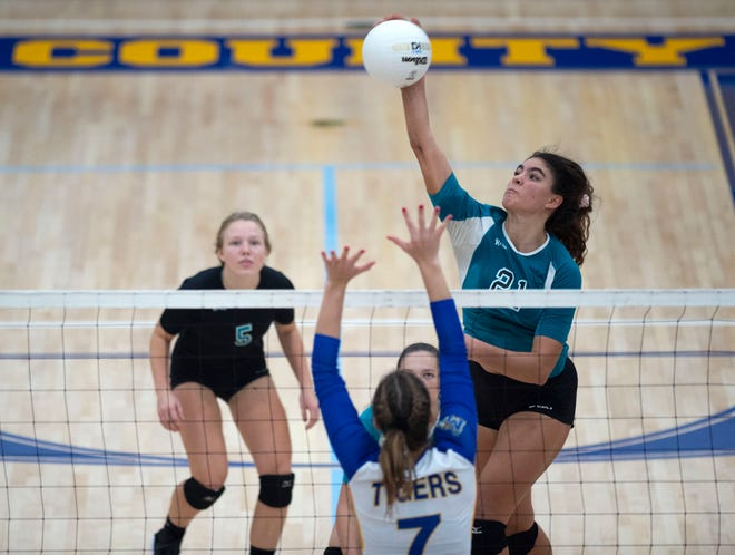 Jensen Beach's Naiya Sawtelle (21) spikes the ball against Martin County in a volleyball match Wednesday, Sept. 30, 2020, at Martin County High School in Stuart. Jensen Beach won in four sets.