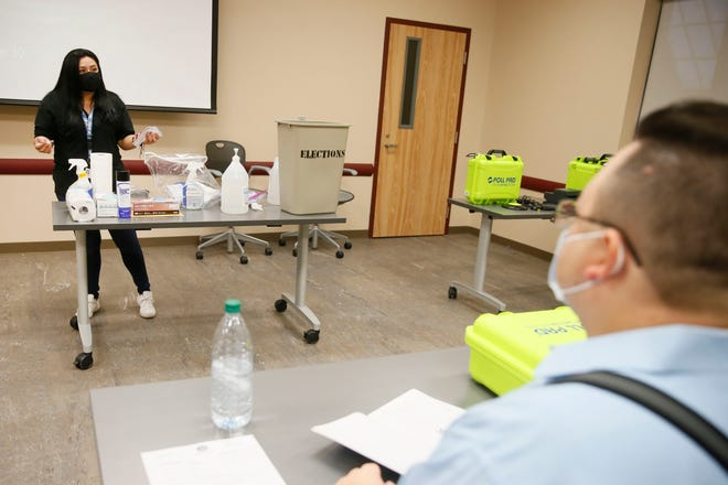 Elections generalists Brenda Negrete goes through sanitization steps in the COVID-19 era during poll worker training Wednesday, Sept. 30, at the County Juvenile Probation Department in El Paso.