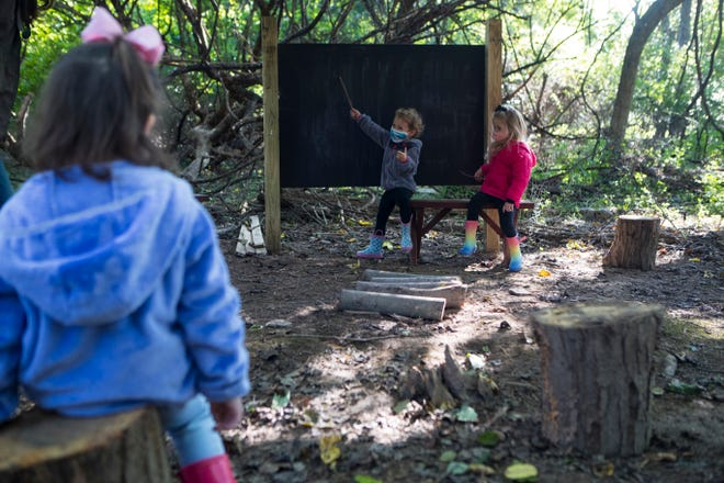 Students at St. Anne's Episcopal School have class at one of the school's multiple wooded classrooms Monday, Sept. 21, 2020, in Middletown. For four years the school has developed an outdoor education program for preschool and prekindergarten students.
