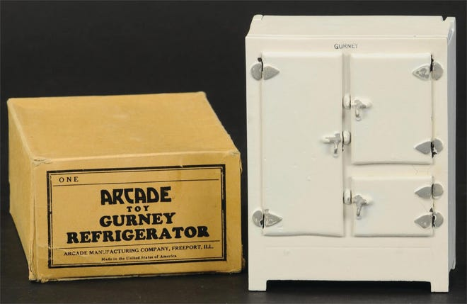 """This toy refrigerator can be dated by the square section that held a block of ice, an early type used from the 1840s. It sold at auction in """"unplayed with"""" condition with a pristine box for more than $1,000."""