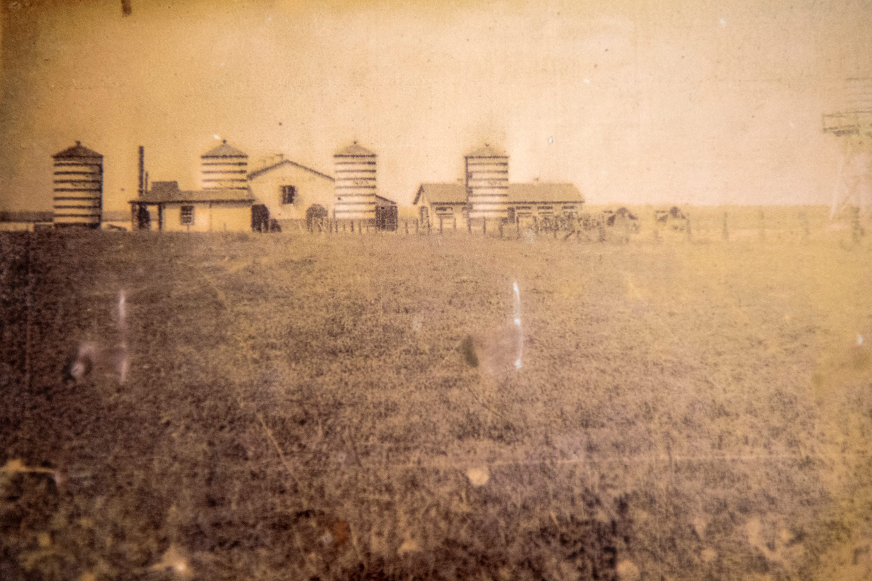 A historical photo shows the Godchaux's Belle Point Dairy, part of the plantation which became Reserve.