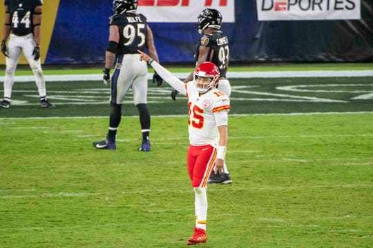 Kansas City Chiefs quarterback Patrick Mahomes (15) reacts after throwing a fourth quarter touchdown  against the Baltimore Ravens at M&T Bank Stadium.