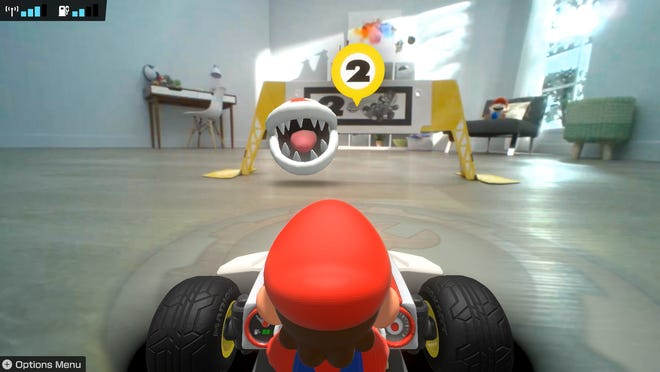 A Piranha Plant awaits at a gate in Mario Kart Live: Home Circuit.