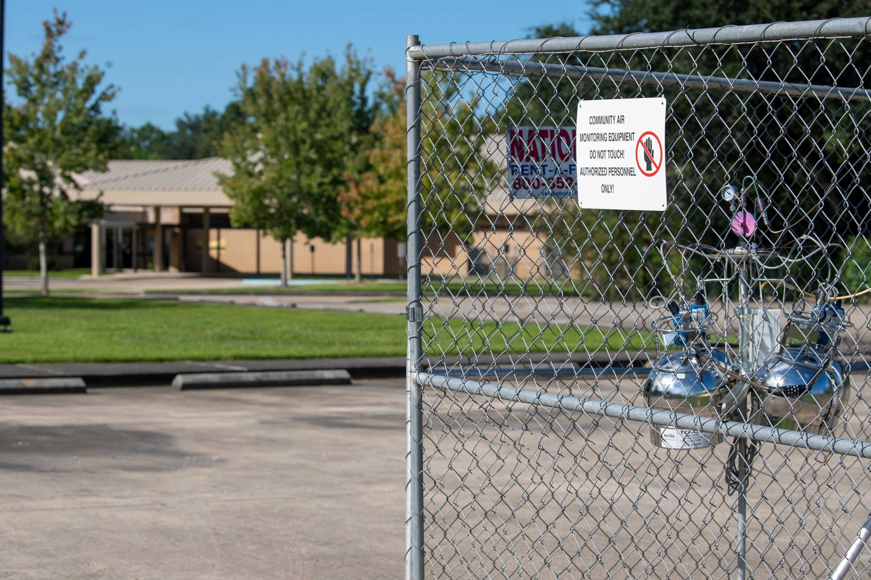 An EPA air monitoring device sits in the parking lot of the 5th Ward Elementary School, just down the street from the Denka Performance Elastomer neoprene plant in Reserve, La. The EPA classified chloroprene as a likely carcinogen in 2010 and has been closely monitoring air quality near the plant since 2016.