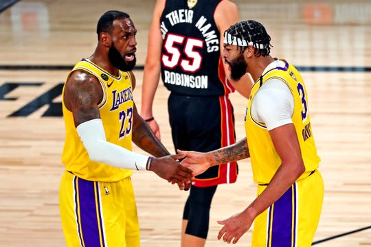 Lakers forwards LeBron James and Anthony Davis celebrate after a play in Game 1 of the NBA Finals.