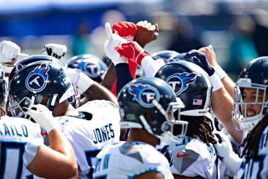Players of the Tennessee Titans huddle together before a game against the Jacksonville Jaguars at Nissan Stadium on September 20, 2020 in Nashville, Tennessee.