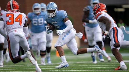 North Carolina's Dazz Newsome looks for running room against Syracuse during their game at Kenan Stadium on Saturday, Sept. 12, 2020, in Chapel Hill, N.C.
