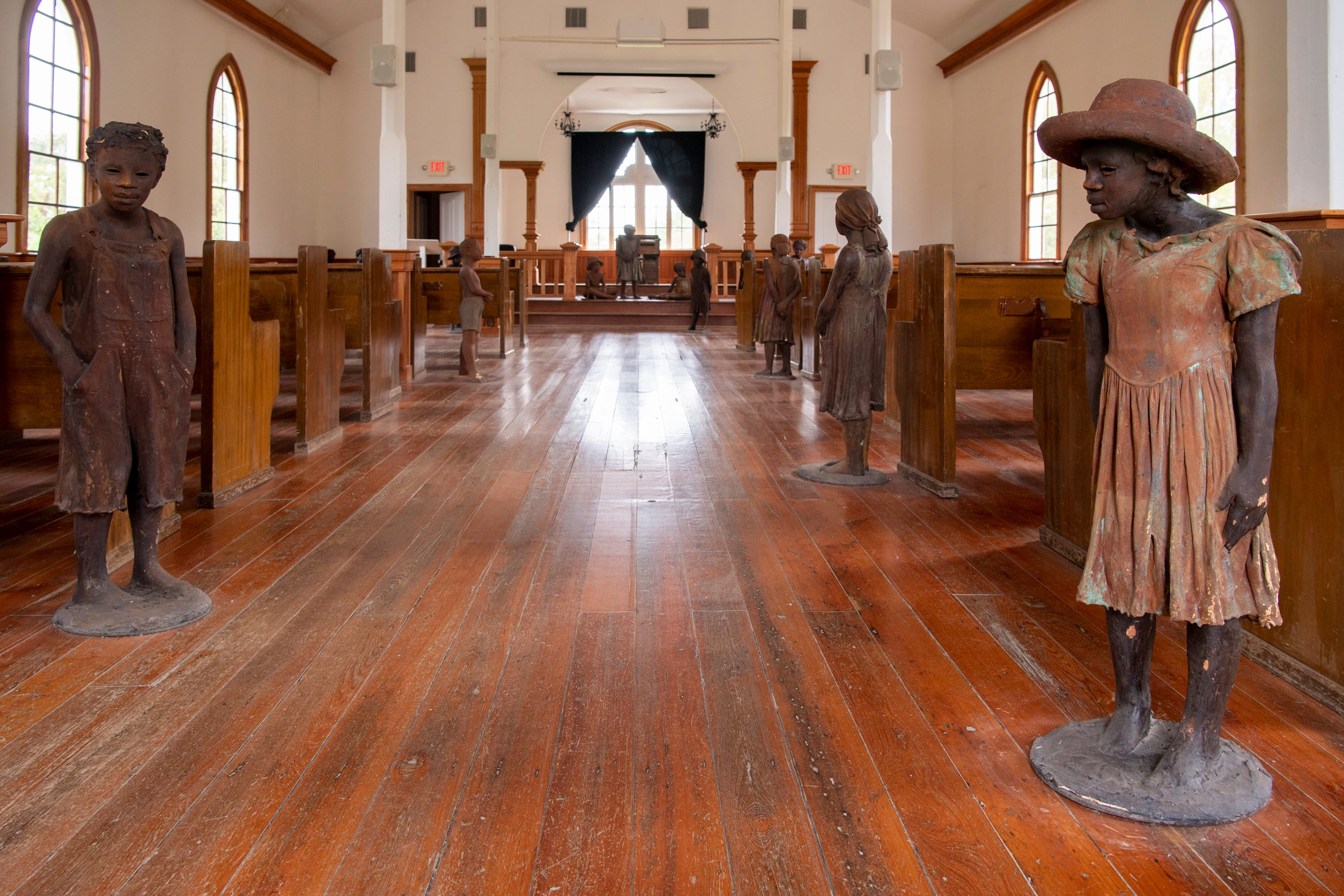 Sculptures of children made by artist Woodrow Nash at the Whitney Plantation Museum, across the Mississippi River from Reserve.  The sculptures stand throughout the Antioch Church built in 1870 by formerly enslaved people.