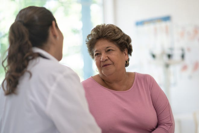 A patient speaks with a doctor