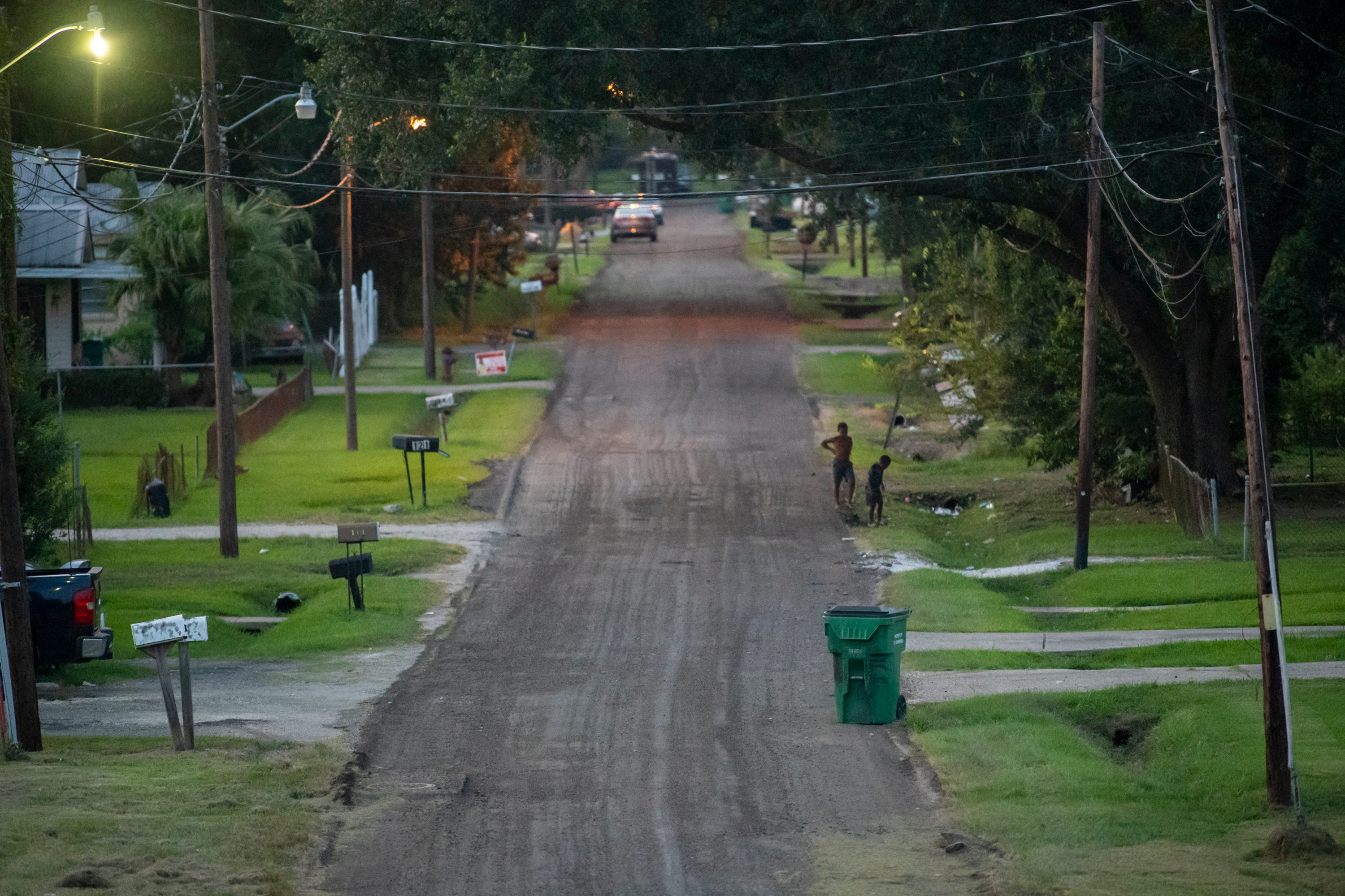 Children play in the residential streets of Reserve, La., just down the road from the Denka Performance Elastomer neoprene plant.