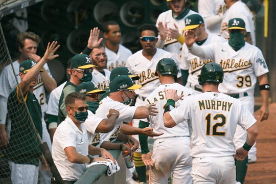 Athletics players celebrate during Game 3.