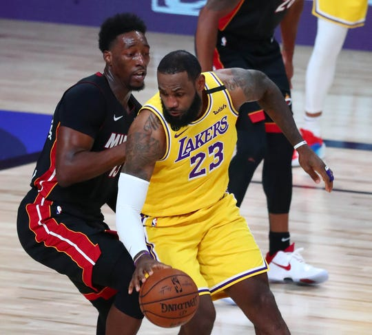 Los Angeles Lakers forward LeBron James (23) and Miami Heat forward Bam Adebayo battle during Game 1 of the NBA Finals.