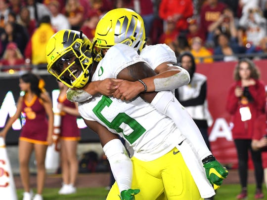 Oregon Ducks running back Travis Dye celebrates with wide receiver Juwan Johnson after he caught a touchdown pass in the second half of the game against the USC Trojans on Nov. 2, 2019.