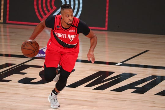 Portland Trail Blazers guard CJ McCollum (3) brings the ball upcourt against the Los Angeles Lakers during the 2020 NBA playoffs.