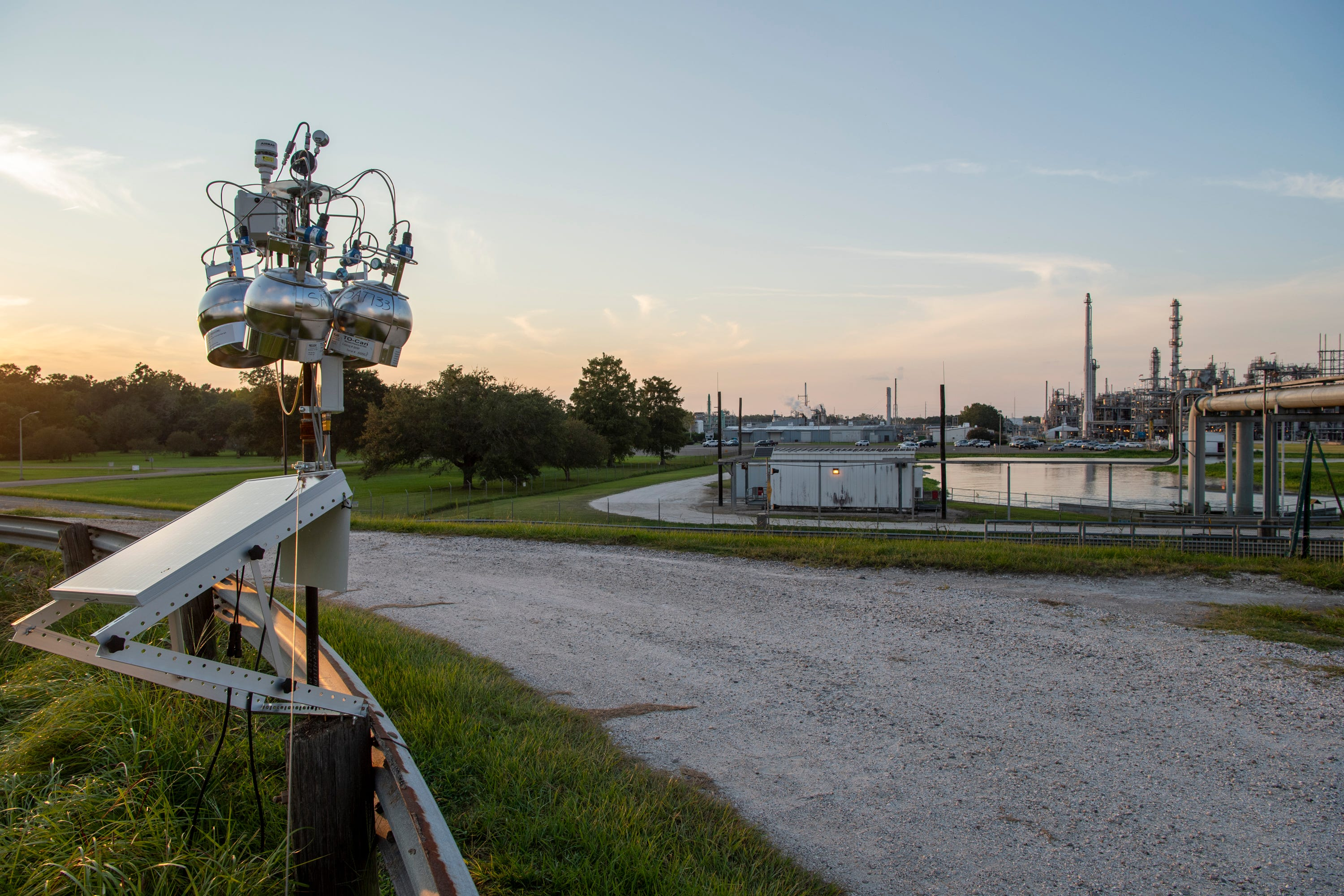 An EPA air monitoring device sits atop a levee across the street from the Denka Performance Elastomer neoprene plant in Reserve, La. The EPA classified chloroprene as a likely carcinogen in 2010 and has been closely monitoring air quality near the plant since 2016.