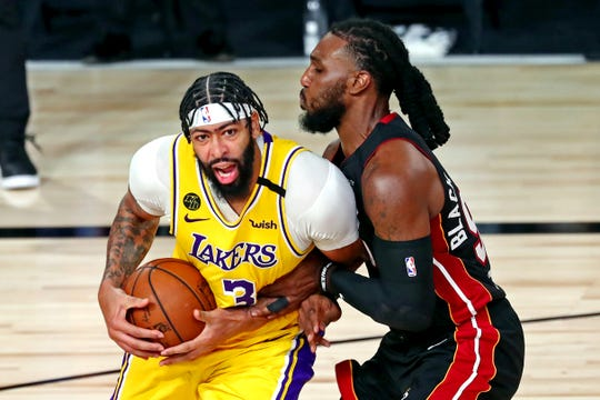 Lakers forward Anthony Davis, left, guarded by Heat forward Jae Crowder, dominated inside to lift Los Angeles to a Game 1 win.