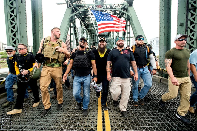 """Members of the Proud Boys, including Joe Biggs of Ormond Beach, third from right, and other right-wing demonstrators march across the Steel Bridge on Aug. 17, 2019, in Portland, Oregon. Biggs had organized an """"End Domestic Terrorism"""" rally there as an anti-Antifa rally."""