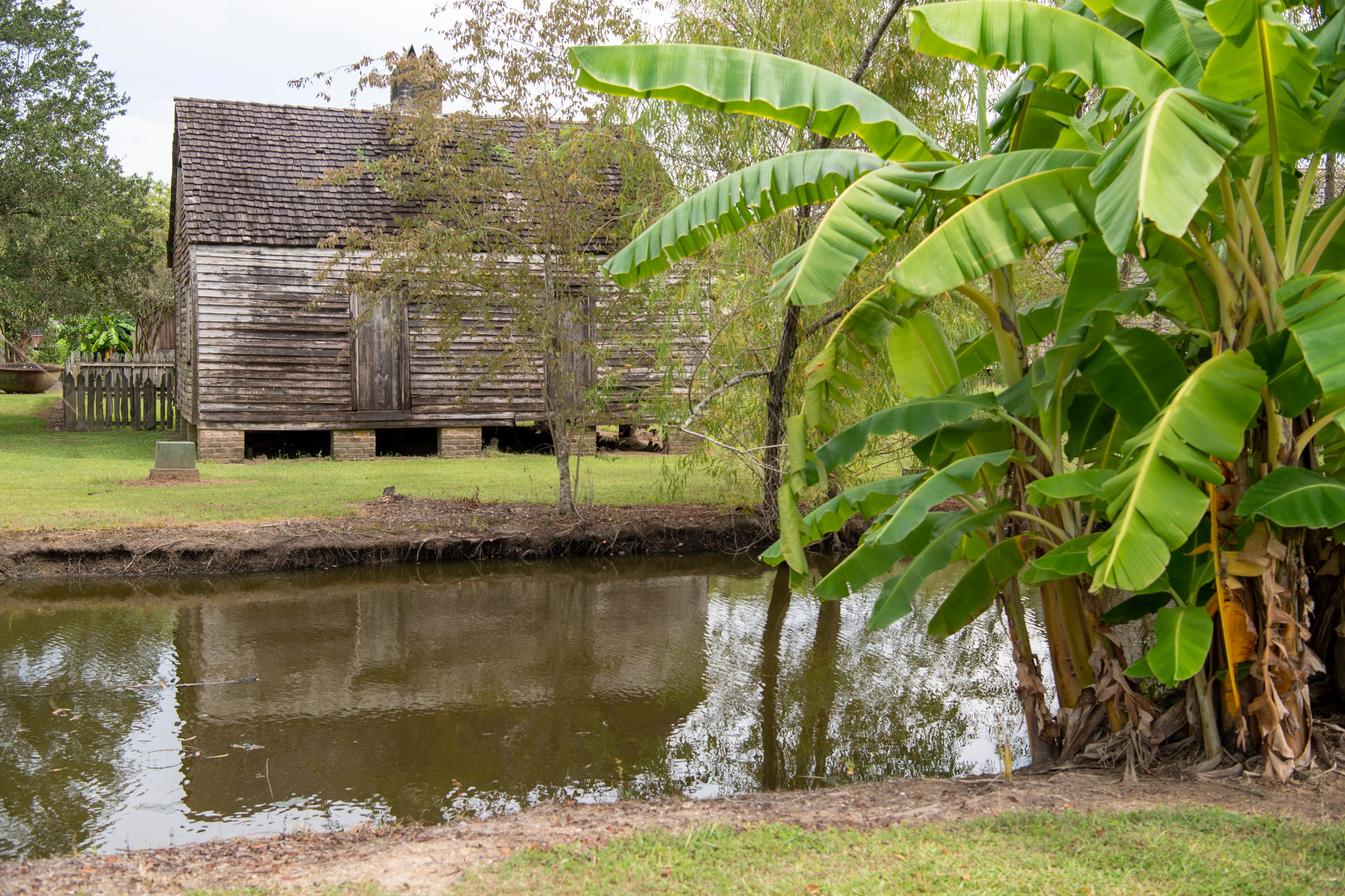 One of seven slave dwellings sits beside a drainage canal at the Whitney Plantation Museum in Wallace, La. The plantation originally had 22 such dwellings.